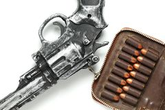 Gun and bullet scene. The plastic toy gun put bee with full load of old and dirty spare pistol bullet as background represent the weapon and bullet concept Stock Photography