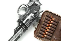 Gun and bullet scene. The plastic toy gun put bee with full load of old and dirty spare pistol bullet as background represent the weapon and bullet concept Royalty Free Stock Images