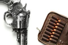 Gun and bullet scene. The plastic toy gun put bee with full load of old and dirty spare pistol bullet as background represent the weapon and bullet concept Royalty Free Stock Photography