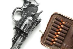 Gun and bullet scene. The plastic toy gun put bee with full load of old and dirty spare pistol bullet as background represent the weapon and bullet concept Royalty Free Stock Image