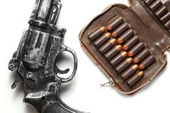 Gun and bullet scene. The plastic toy gun put bee with full load of old and dirty spare pistol bullet as background represent the weapon and bullet concept Stock Photo