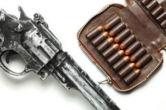 Gun and bullet scene. The plastic toy gun put bee with full load of old and dirty spare pistol bullet as background represent the weapon and bullet concept Stock Photos