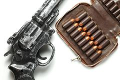 Gun and bullet scene. The plastic toy gun put bee with full load of old and dirty spare pistol bullet as background represent the weapon and bullet concept Royalty Free Stock Photo