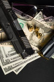 Gun with bullet on US dollar banknotes Stock Image