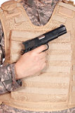 Gun and bulletproof vest Royalty Free Stock Image