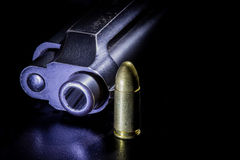 Gun and bullets Royalty Free Stock Photography