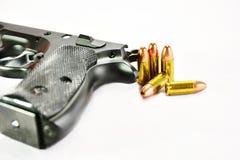 Gun and Bullets. Black Guns and ammunition Bullet Stock Photo