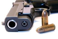Gun and bullets. Close up of 9mm gun and bullets Stock Photography