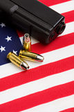 Gun and bullets on flag Stock Photography