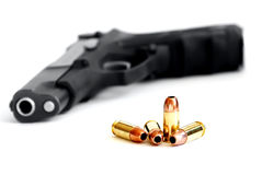 Gun with Bullets in Front Stock Photos