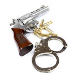 Gun, bullets and handcuffs Royalty Free Stock Photography