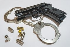 Gun, bullets and handcuffs Royalty Free Stock Images