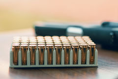 Gun with bullets. Handgun box with new ammunition. Stock Images