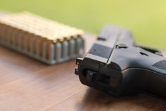 Gun with bullets. Handgun box with new ammunition. Royalty Free Stock Photo