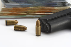 Gun bullets and money Royalty Free Stock Images