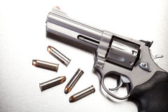 Gun with bullets on steel royalty free stock image