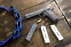 Gun and bullets on a table Stock Image