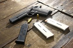 Gun and bullets on a table Stock Images