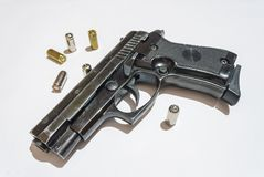 Gun and bullets Stock Photos