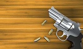 Gun with bullets. On wooden background Royalty Free Stock Photo
