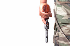 With a gun and camouflage pants. Close up over white background Royalty Free Stock Images