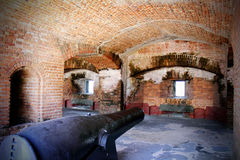 Gun Cannon in Bunker. Old historical bunker with immobilized gun cannon inside brick arches of a Fort in Key West Florida. Zachary Taylor State Park. Gun rooms stock photo