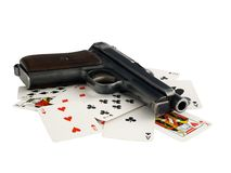 Gun and cards Royalty Free Stock Photography