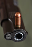 Gun and cartridge Stock Images