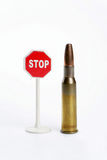 Gun cartridge and sign. Stop on a white background Stock Photo