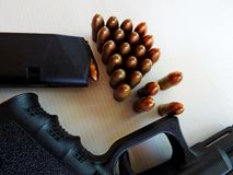 Gun and cartridges. Of 9 mm Royalty Free Stock Photos