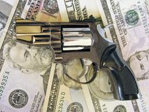 Gun on cash Stock Image