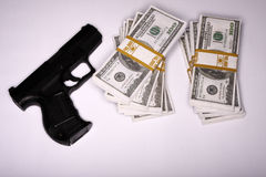 Gun and cash Stock Photography