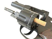 Gun with cigarette Stock Image