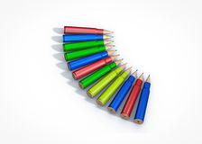 Gun clip made out of colored pencils. Education against violence Royalty Free Stock Photo