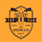 Gun club vintage logo. Vector emblem with revolvers on shield, grunge textures can be removed Royalty Free Stock Images