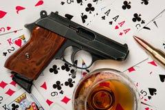 Gun cognac and cards Stock Photos