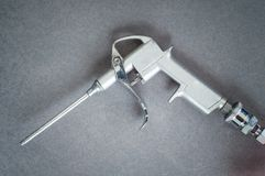 Gun for compressed air. With long tube royalty free stock images