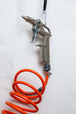 Gun for compressed air. With wire hooked to a nail stock images