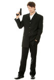 Gun control concept. Businessman with handgun, isolated on white stock images