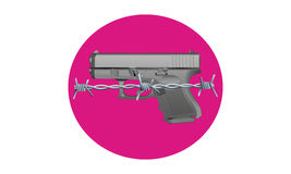 Gun Control - A Grey Metal Handgun on top of Pink Circle with Barbed Wire Across Royalty Free Stock Photos