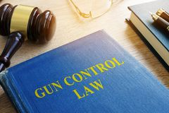 Gun control law in a court. Gun control law and gavel in a court Royalty Free Stock Photo