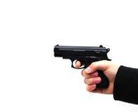 Gun crime. Shot of an arm holding a gun Royalty Free Stock Photography