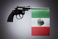 Gun crime concept of hand pistol. Showing the flag of mexico stock photo