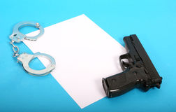 Gun and Cuffs Stock Photos