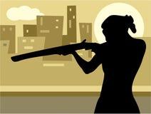 Gun Culture. Woman pointing a rifle Stock Photo