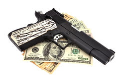 Gun and dollars Stock Photos