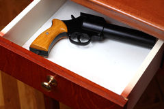 Gun in drawer. Flare gun forgotten in old desk drawer Stock Images