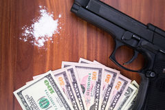 Gun, drugs and money on wooden background. Top view Royalty Free Stock Images