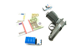 Gun, euros and police cars. Gun, banknotes and police cars closeup on white Stock Photography