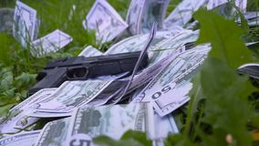 Gun falls on the money stock footage